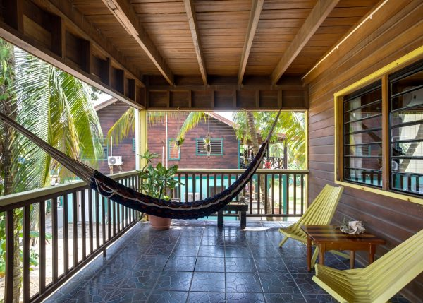 Front veranda with chairs and hammocks