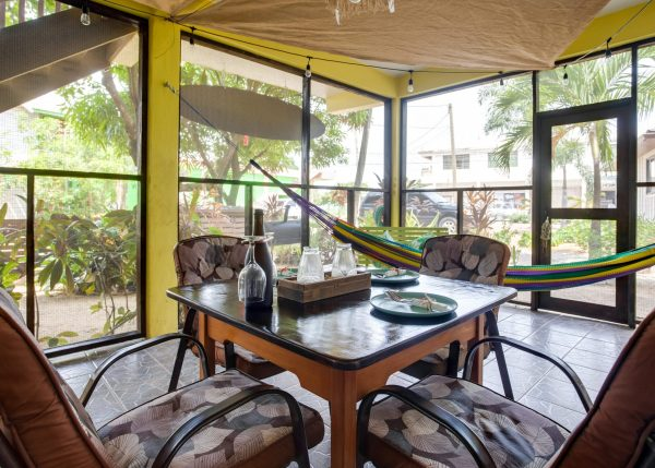 Veranda with chairs and hammock with view of yard